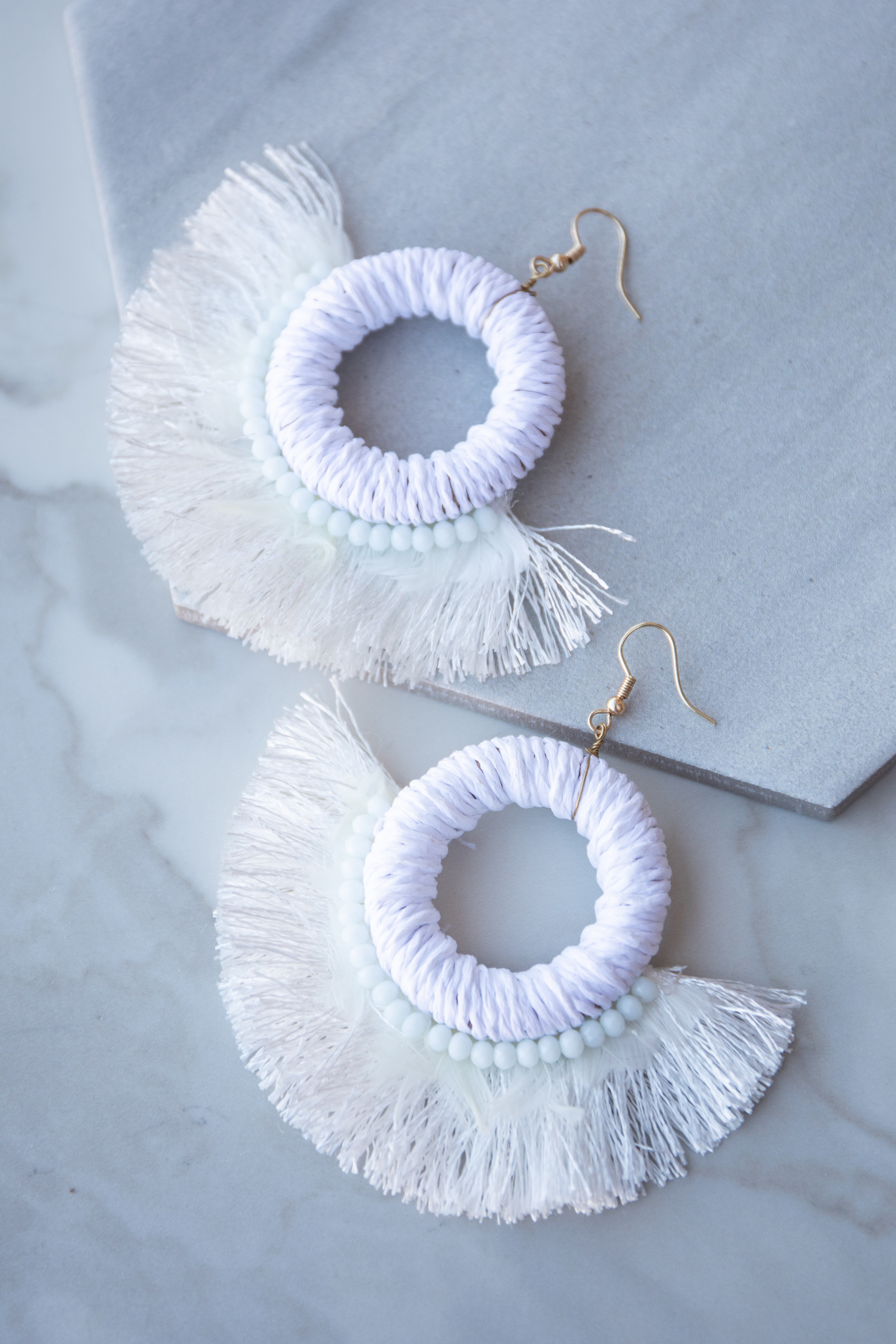 Off White Hoop Earrings with Bead and Feather Details