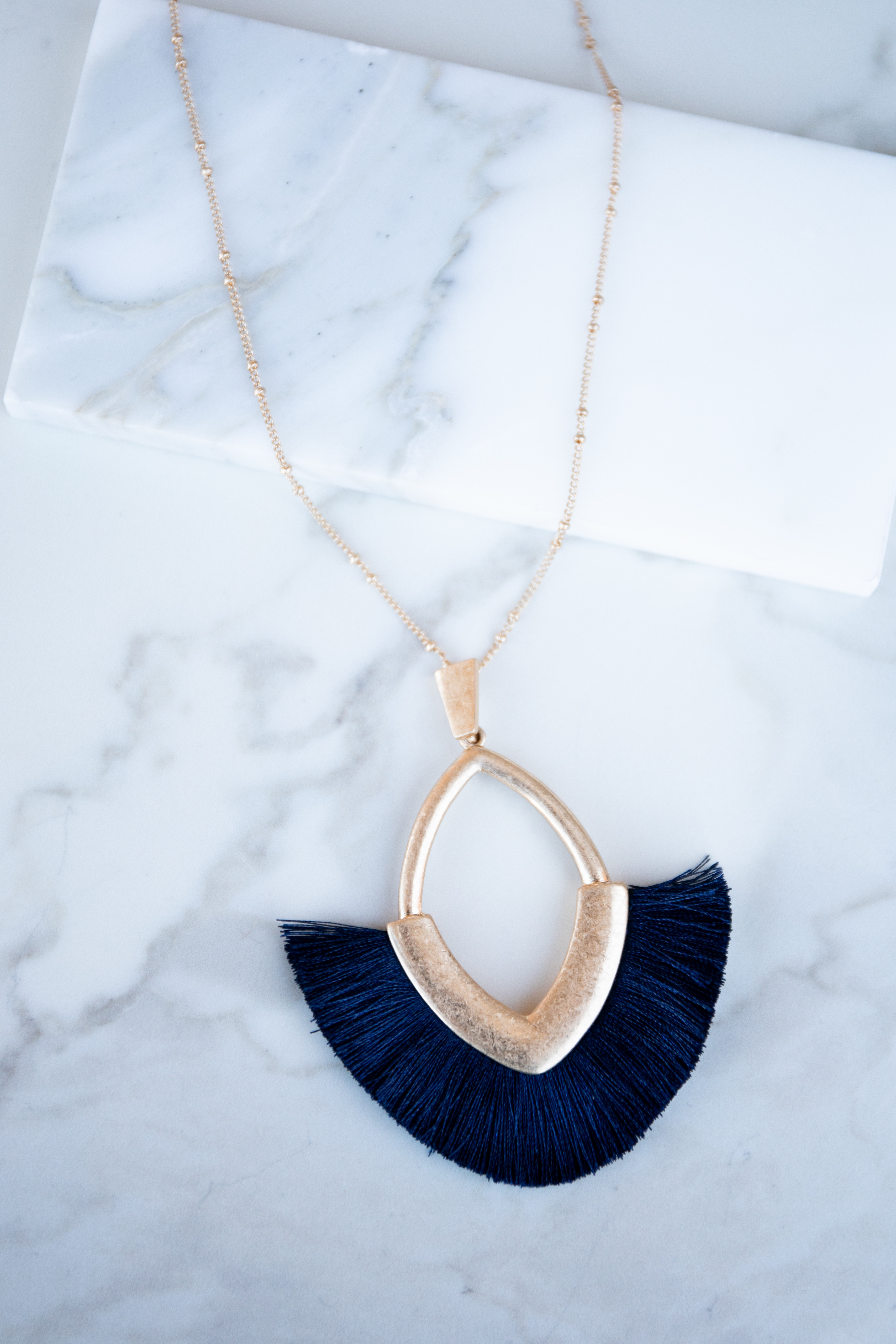 Gold Long Necklace with Pendant and Navy Fringe Detail