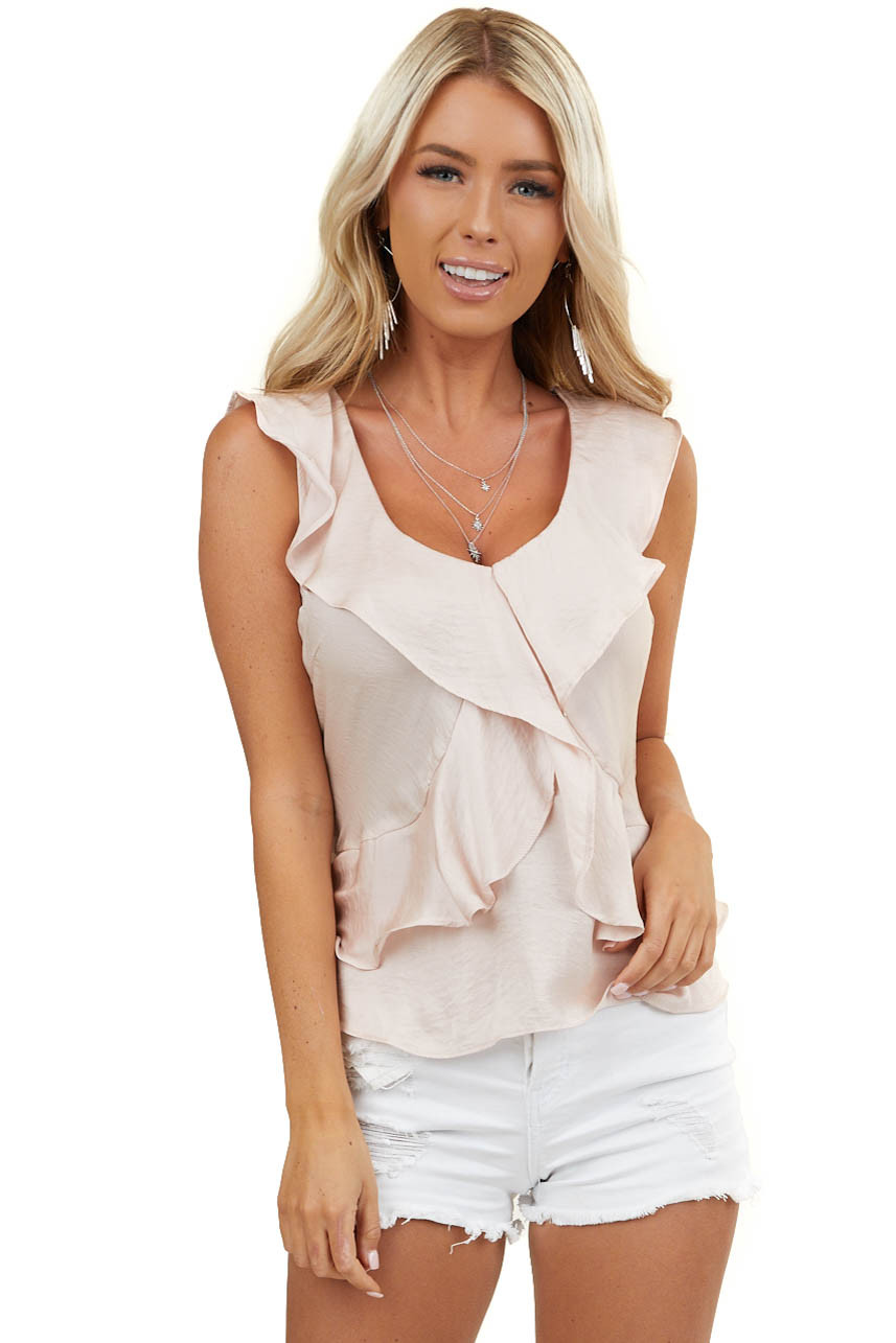 Blush Sleeveless Blouse with Tie Back and Ruffle Details
