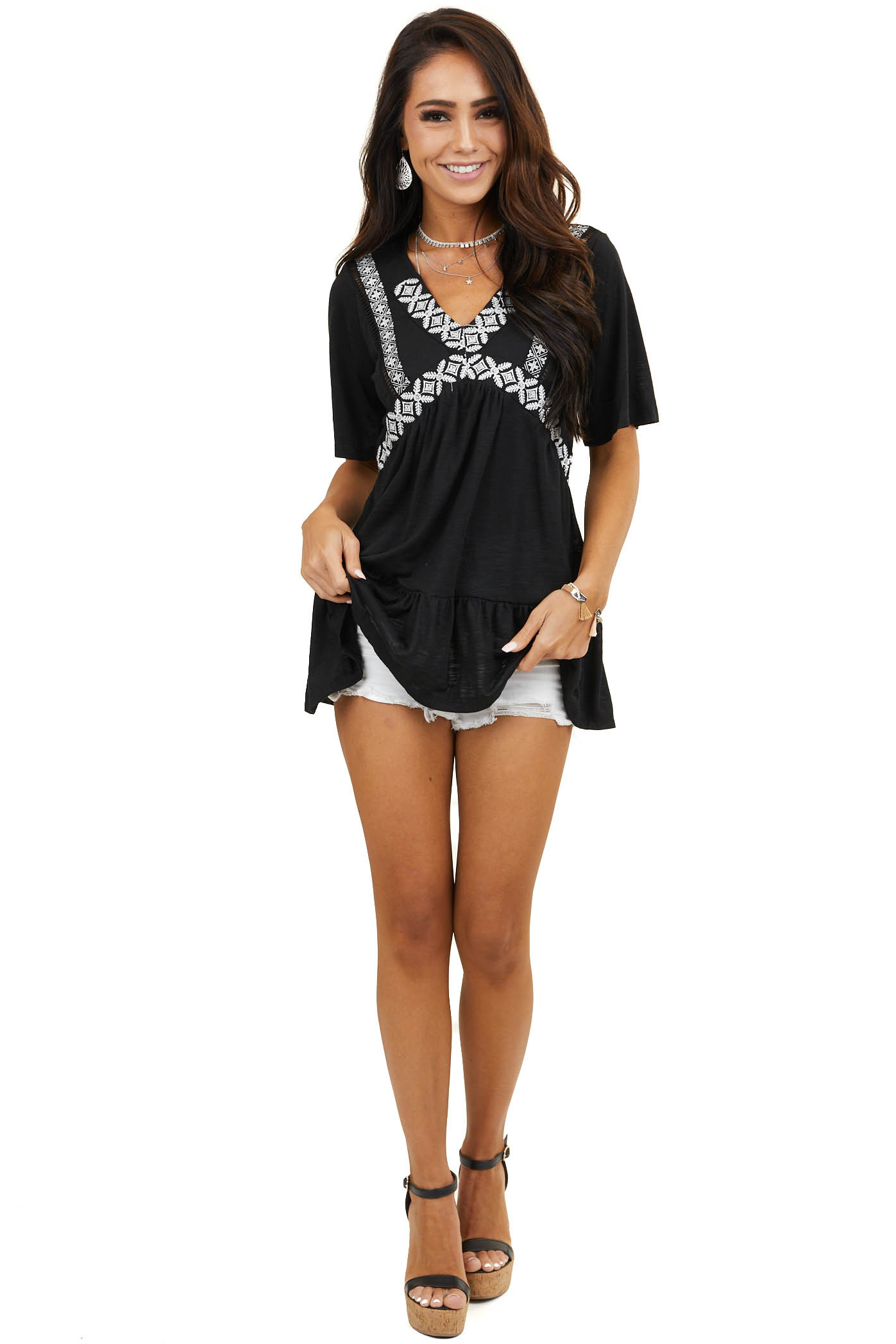 Black Tunic Top with Ruffle Hem and Embroidery Detail