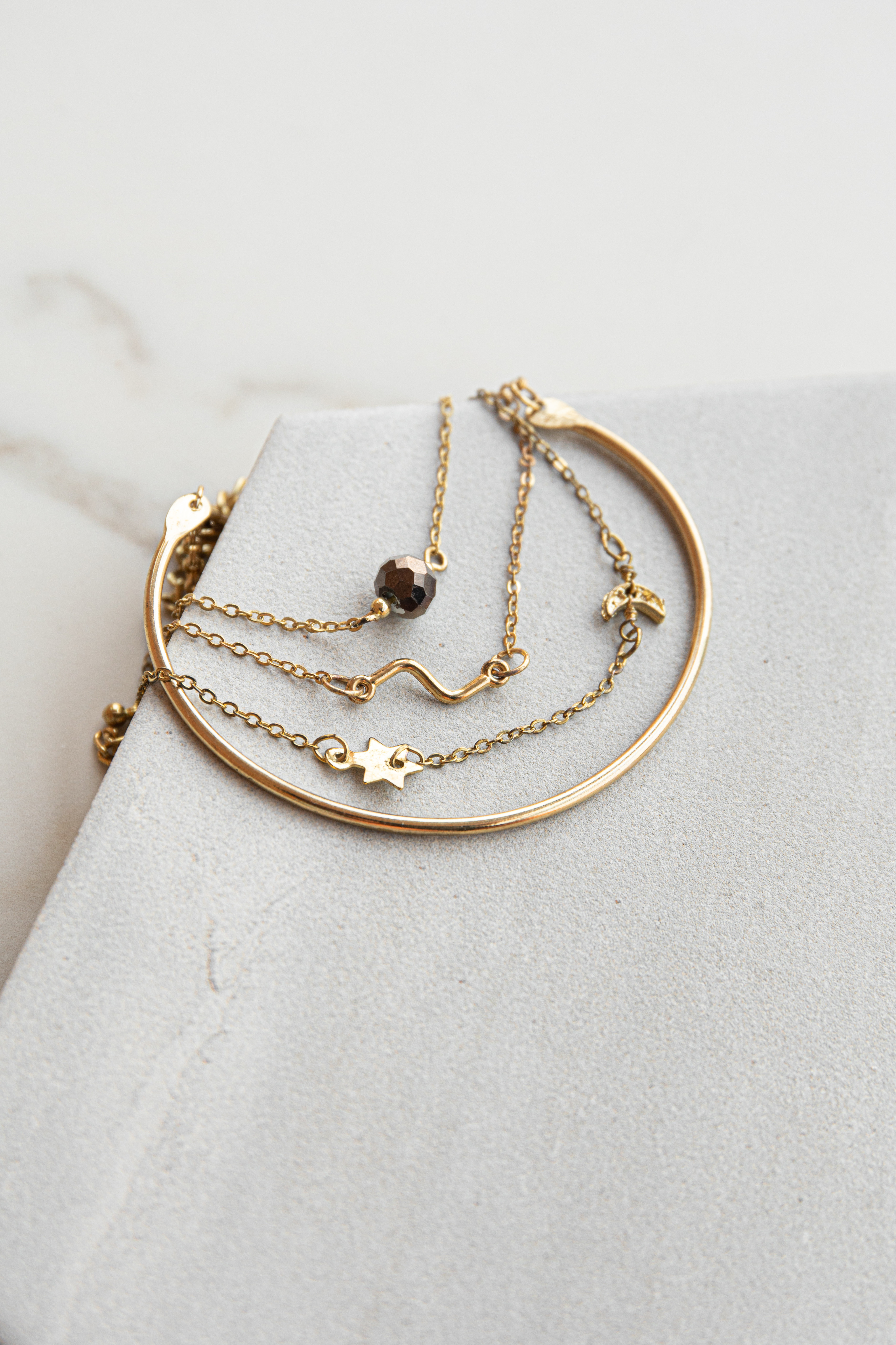 Gold Bracelet Set with Cuff and Tiny Charm Details