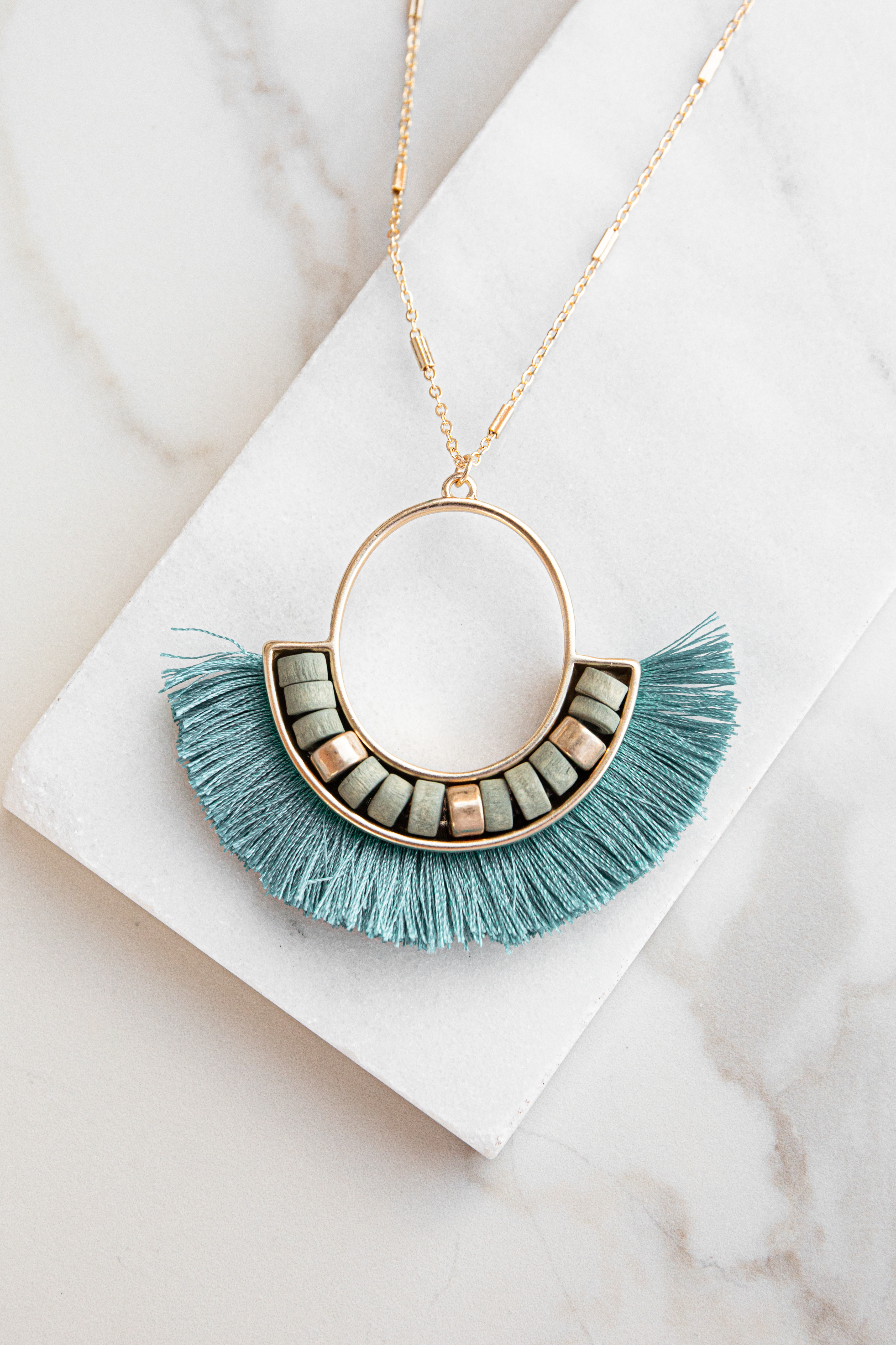 Gold Circle Pendant Long Necklace with Teal Tassel Details