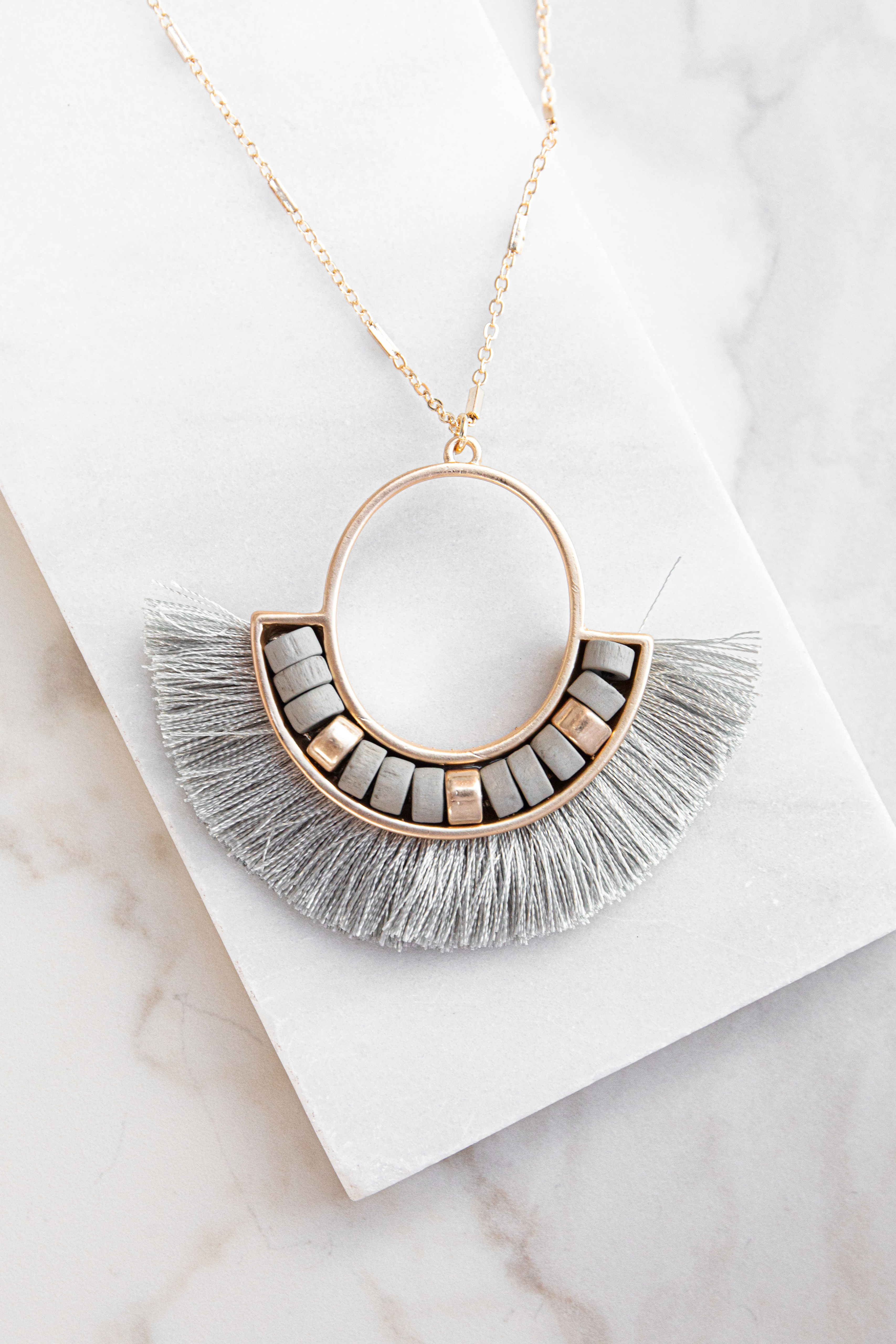 Gold Circle Pendant Long Necklace with Grey Tassel Details