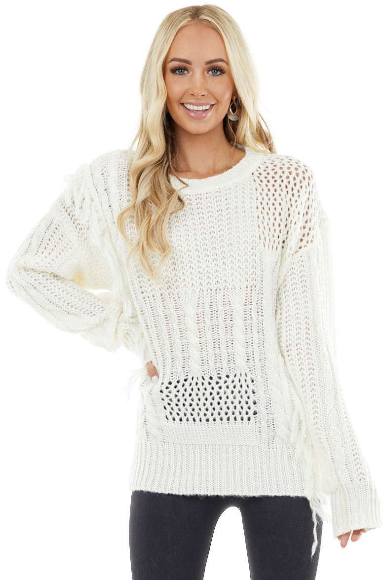 Ivory Cable Knit Sweater with Loose Knit Details and Fringe