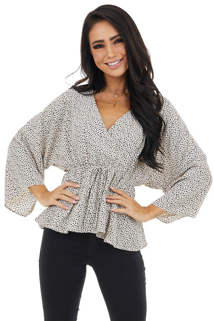 Beige Printed Surplice Peplum Blouse with Flowy 3/4 Sleeves