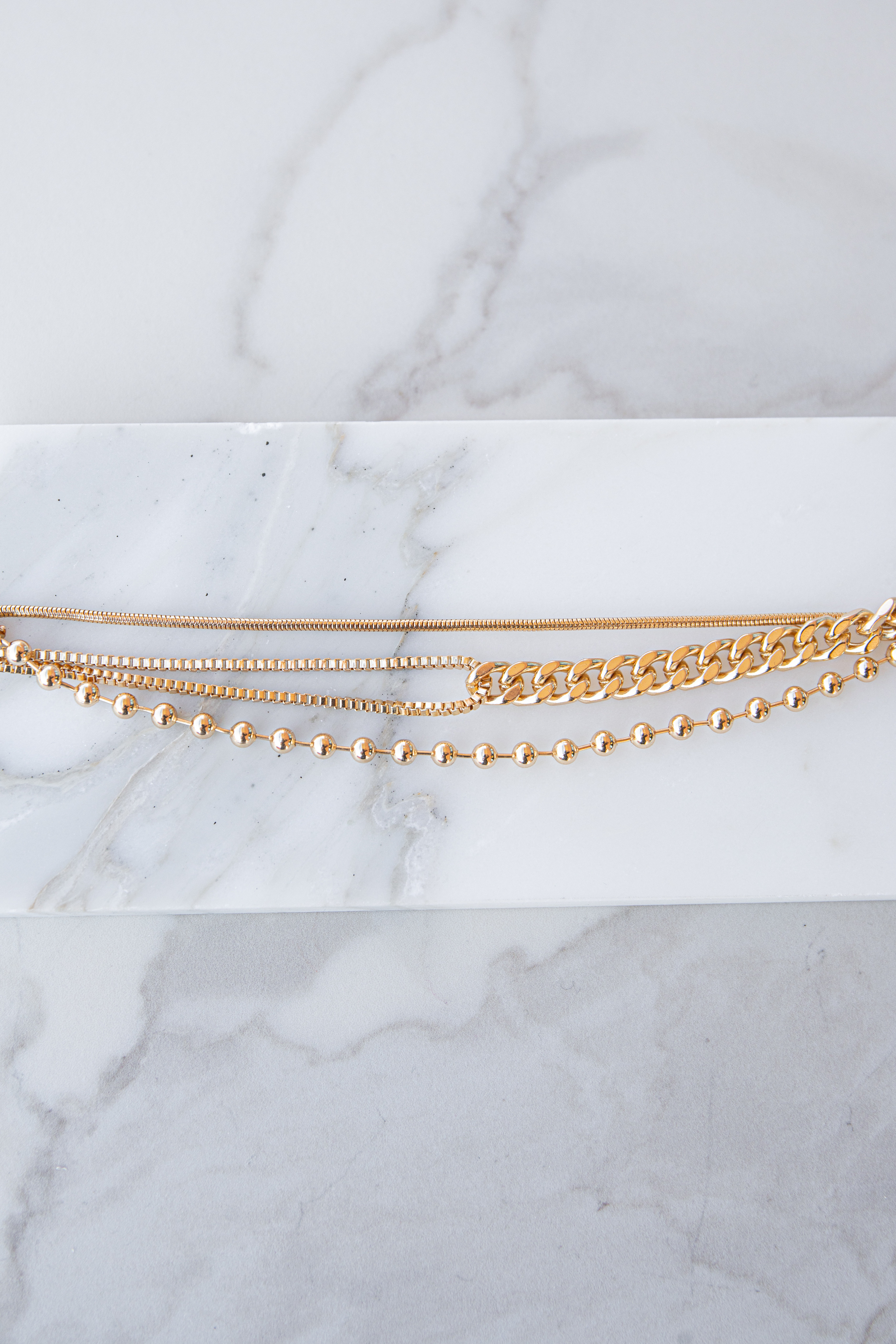Gold Layered Multi Chain Bracelet with Lobster Clasp Closure