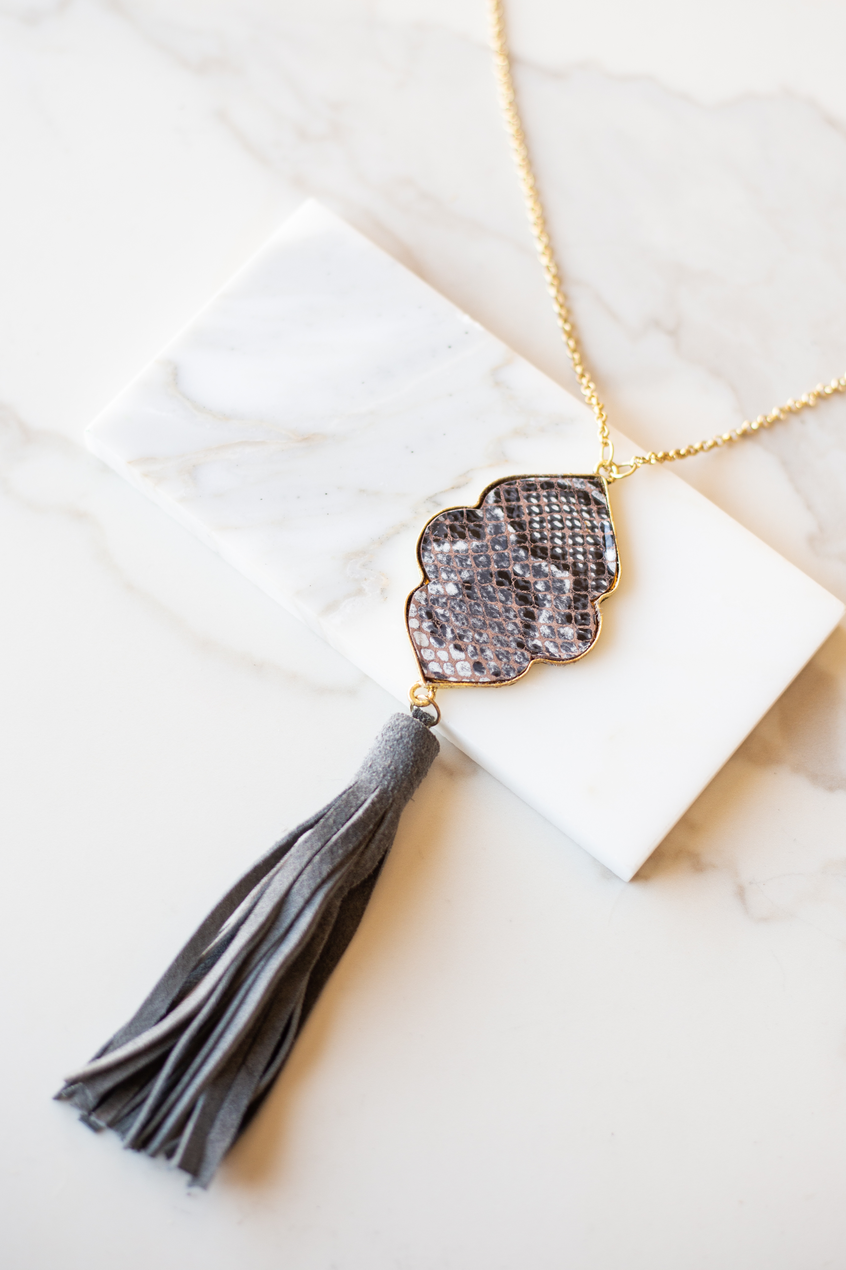Gold Long Necklace with Snakeskin Print Pendant and Tassel
