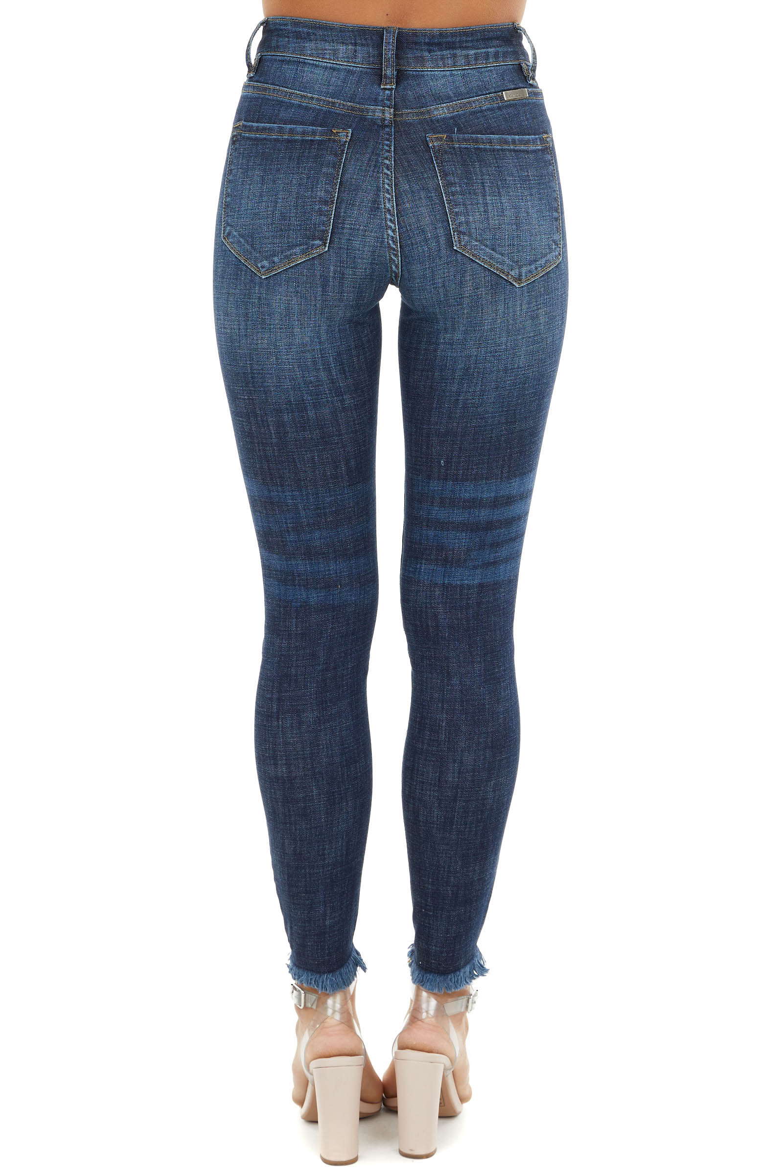 Dark Wash High Rise Skinny Jeans with Distressed Hemline
