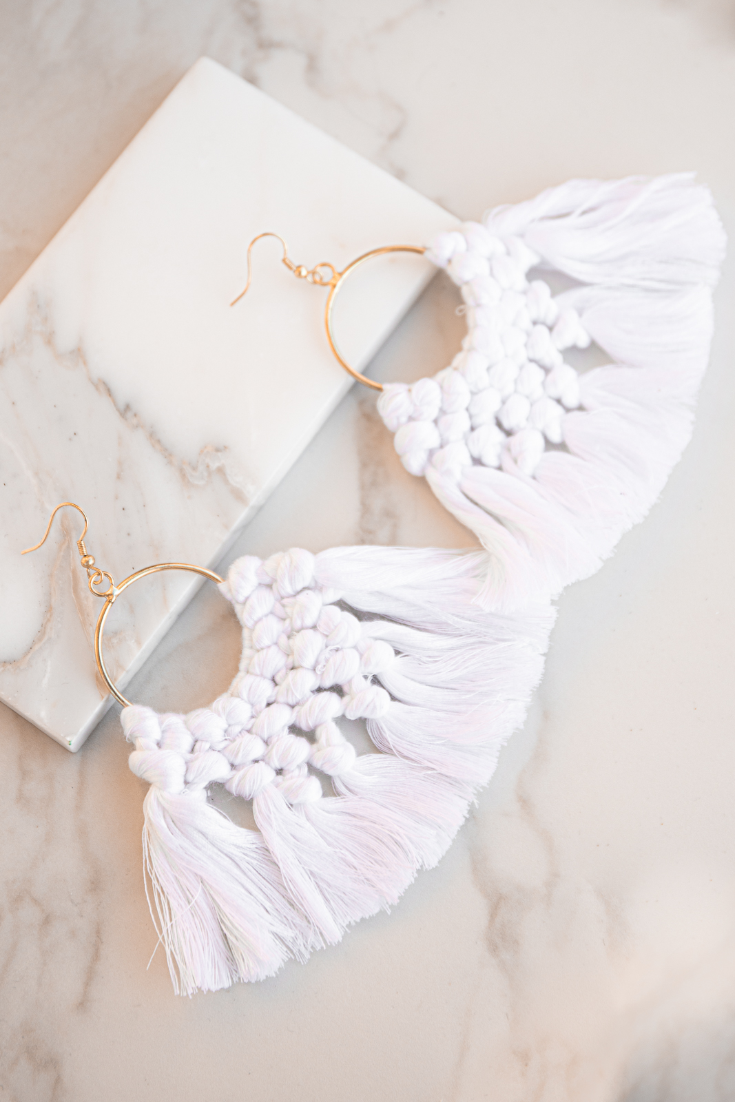 Gold Hoop Earrings with White Tassels and Woven Details