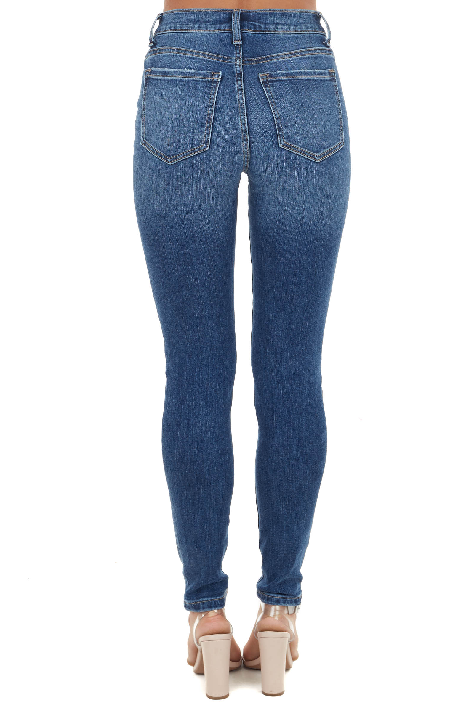 Medium Wash Mid Rise Skinny Jeans with Distressed Holes