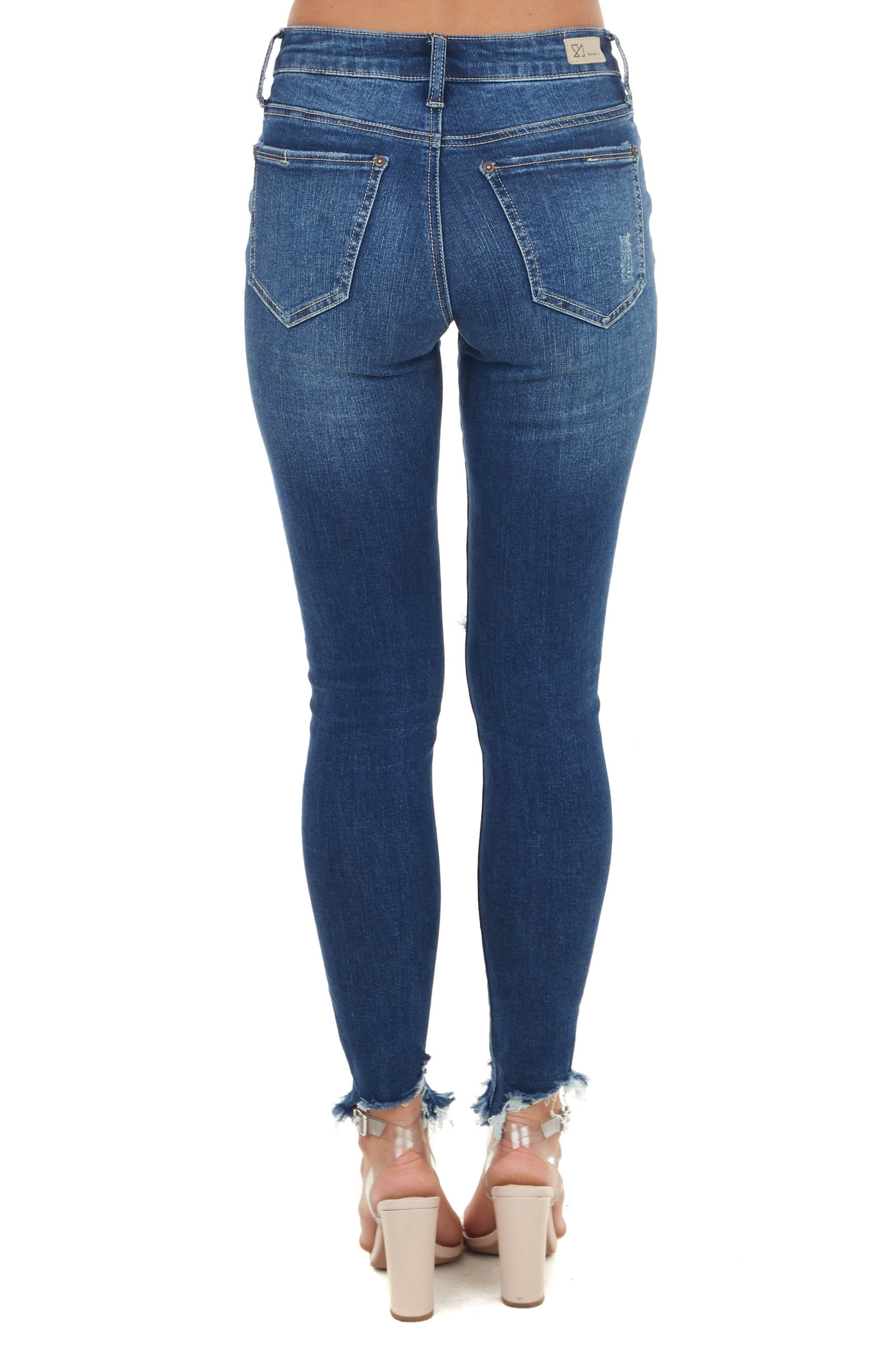 Medium Wash Mid Rise Skinny Jean with Distressed Details