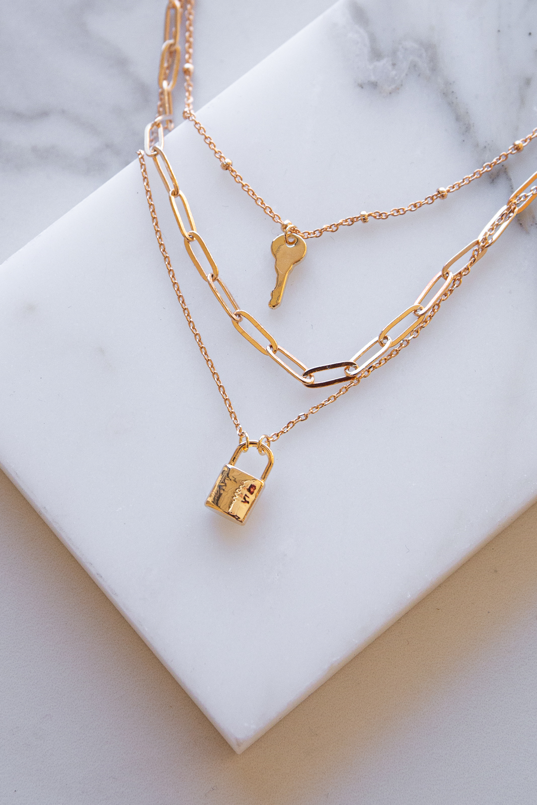 Gold Layered Chain Necklace with Lock and Key Charms