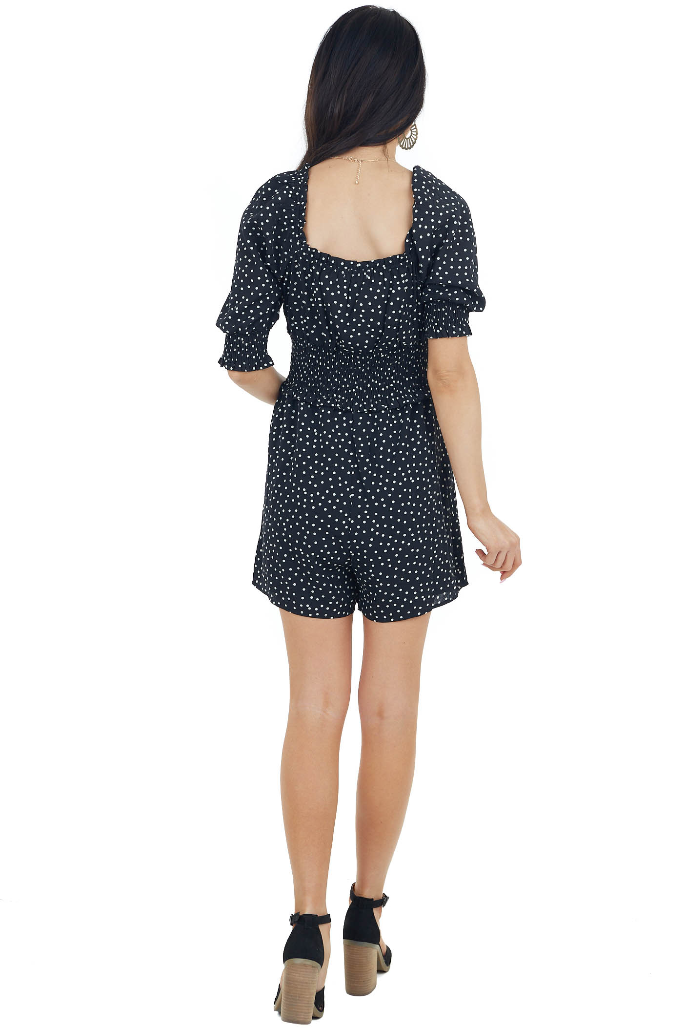 Black and White Polka Dot Smocked Romper with Ruffles Detail