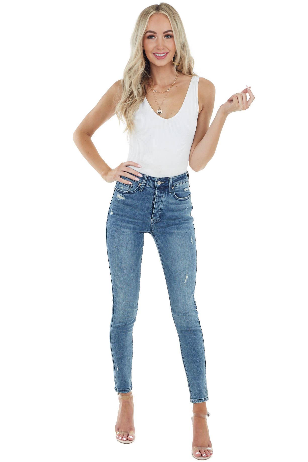 Medium Wash High Rise Skinny Jeans with Light Distressing