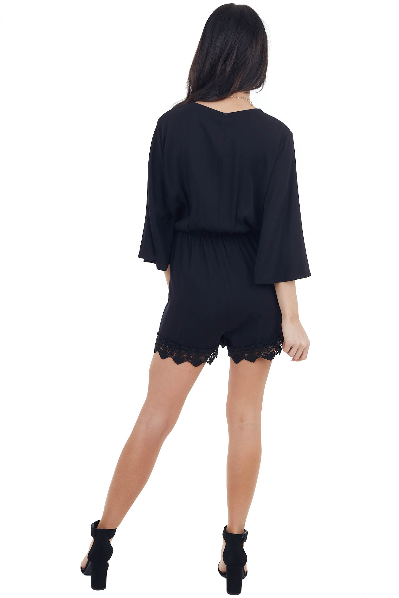 Black Surplice Romper with Pockets and Lace Detail