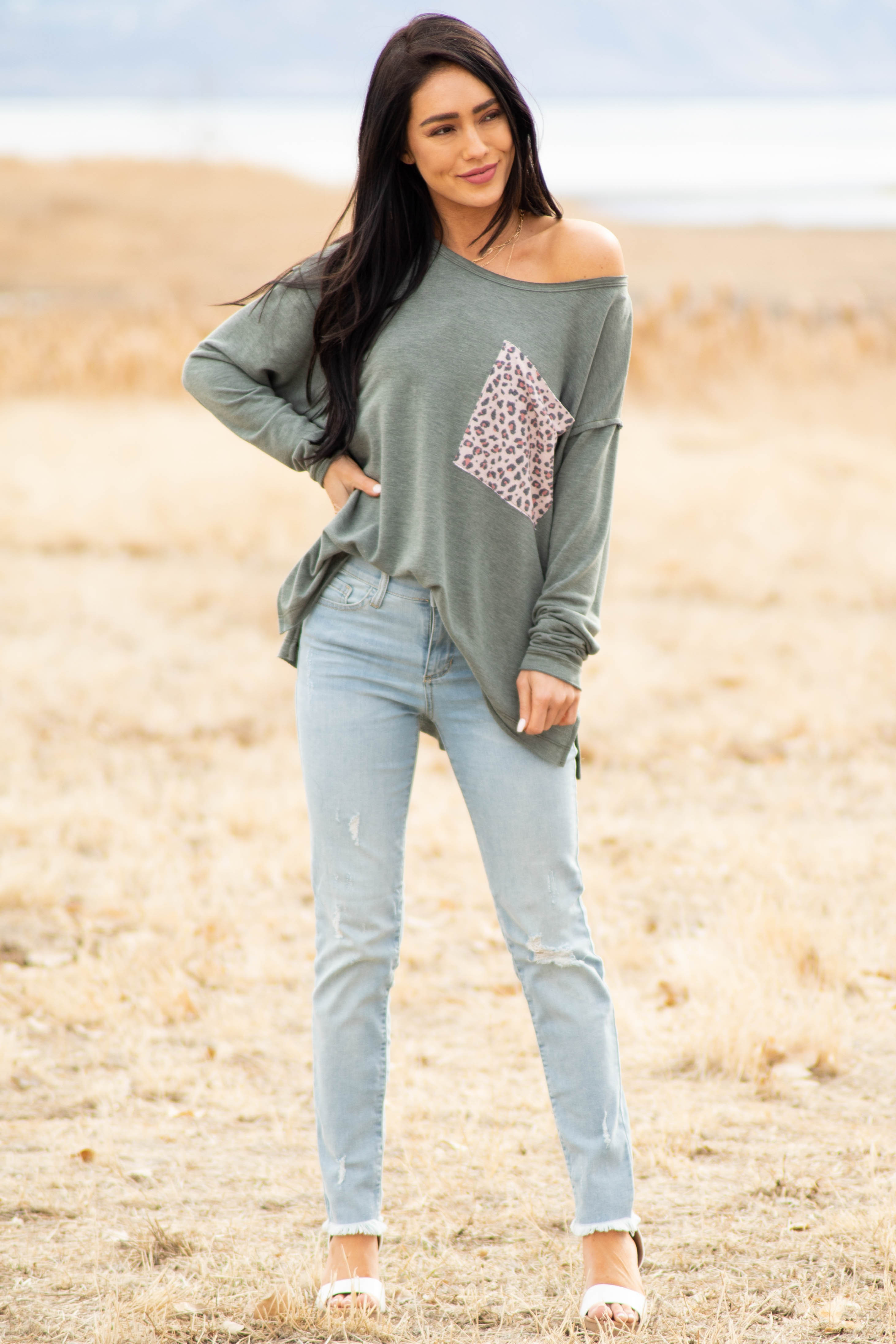 Light Wash Ankle Length Mid Rise Lightly Distressed Jeans