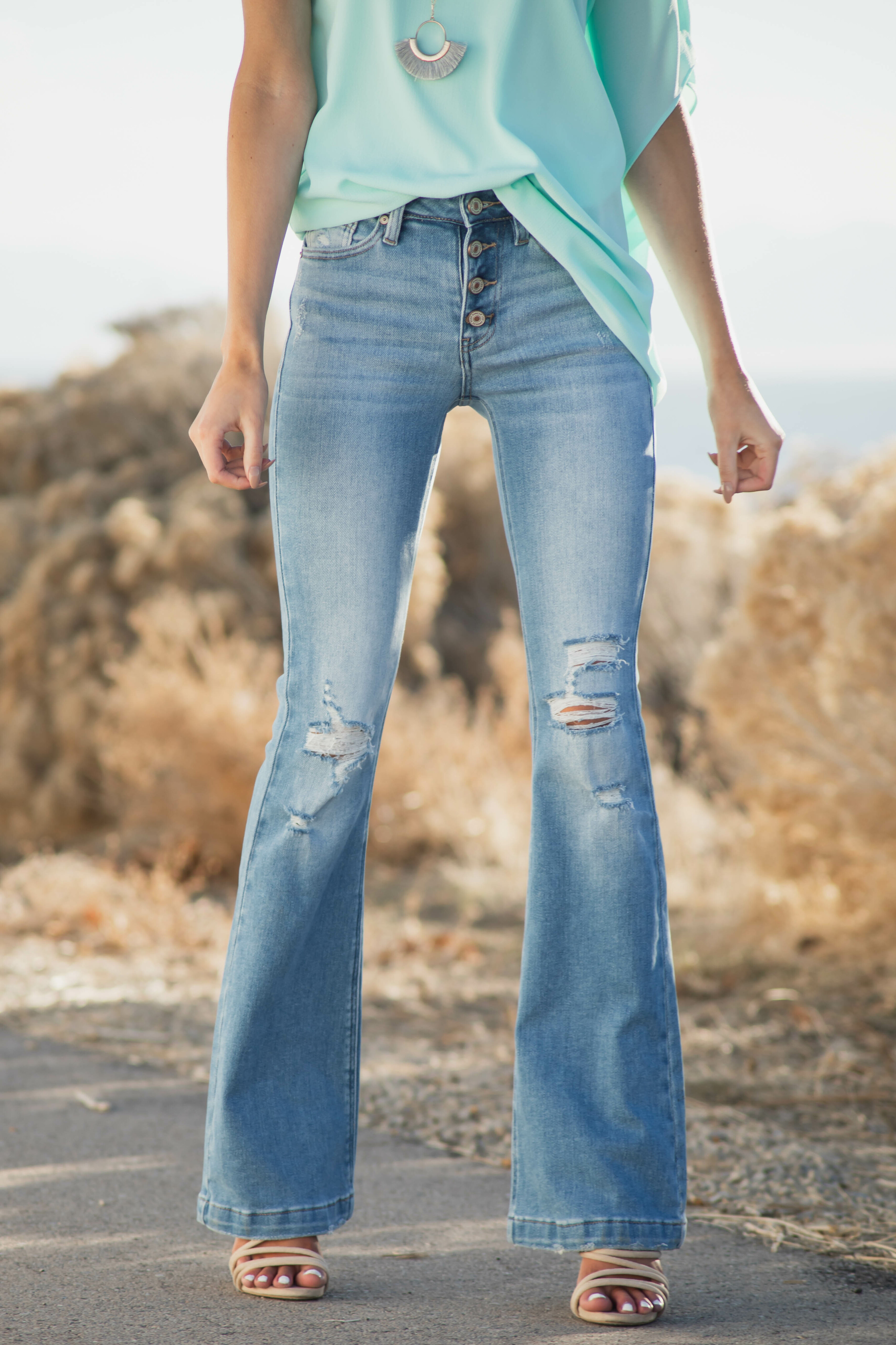 Medium Light Wash High Rise Flare Jeans with Destroyed Knees