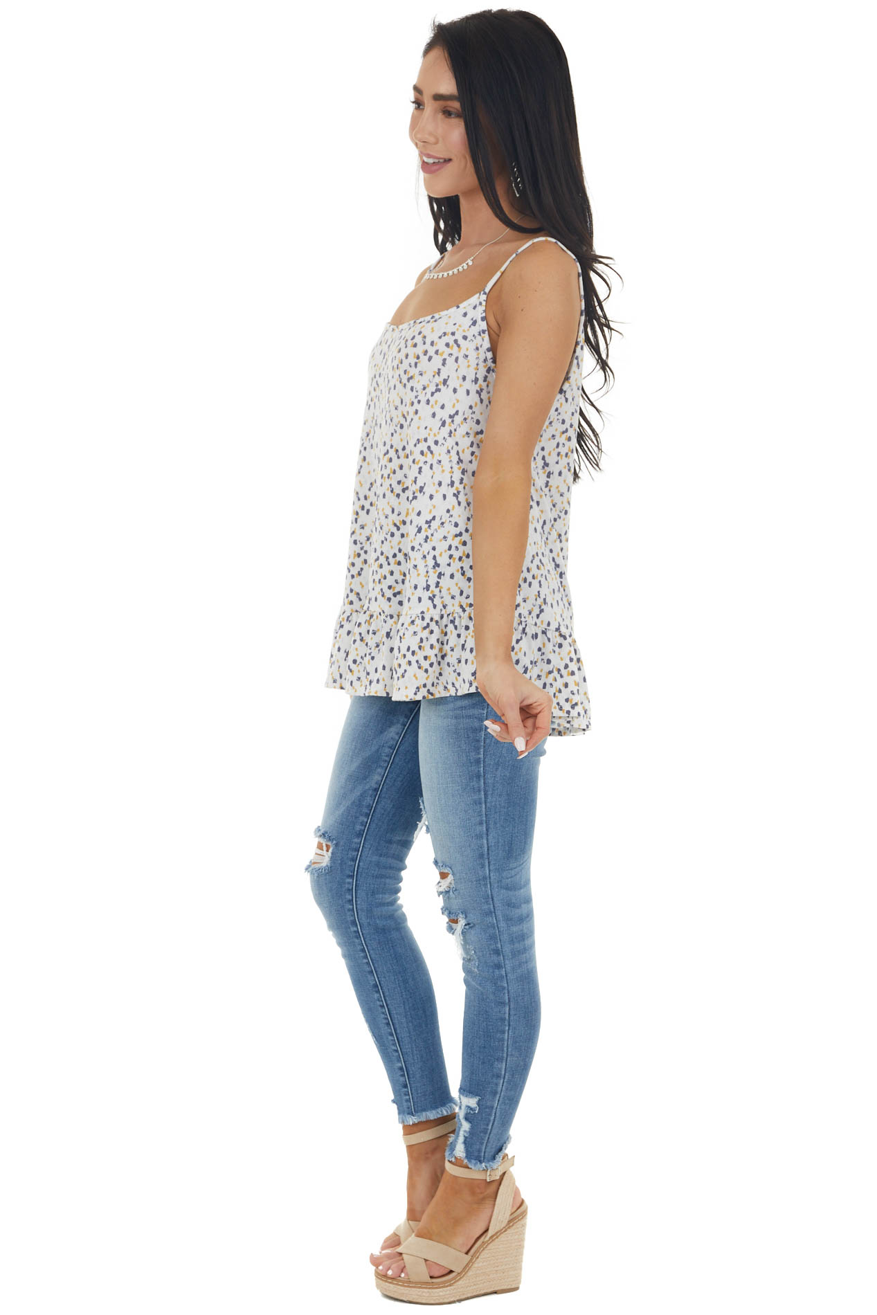 Ivory Printed Sleeveless Knit Top with Ruffle Hemline