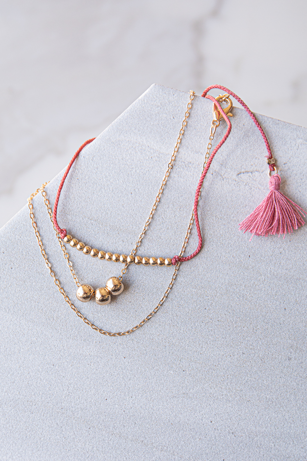 Gold and Berry Beaded Layered Bracelet with Tassel Details