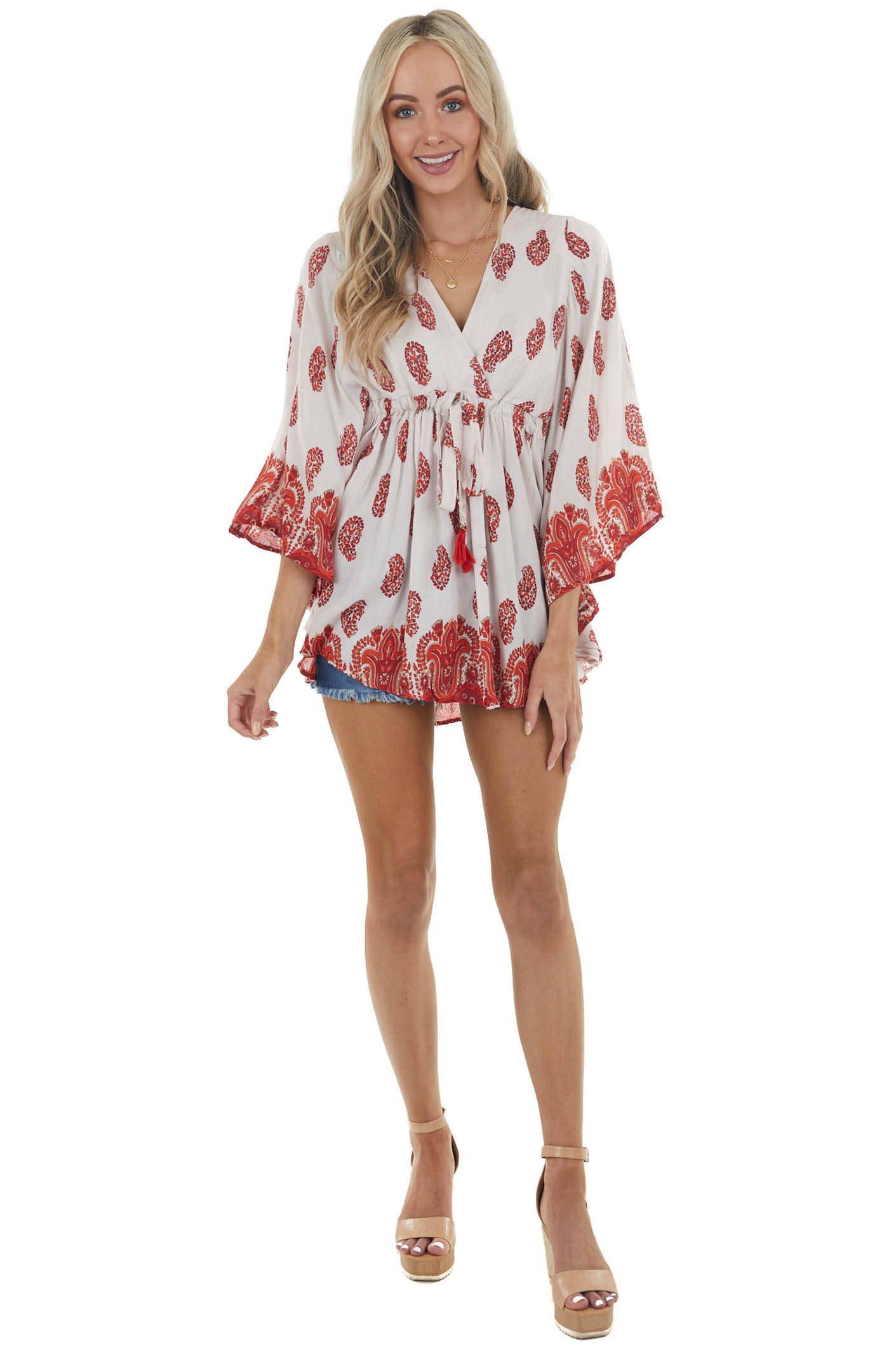 Vanilla Printed Surplice Top with Waist Tie and Tassel Details