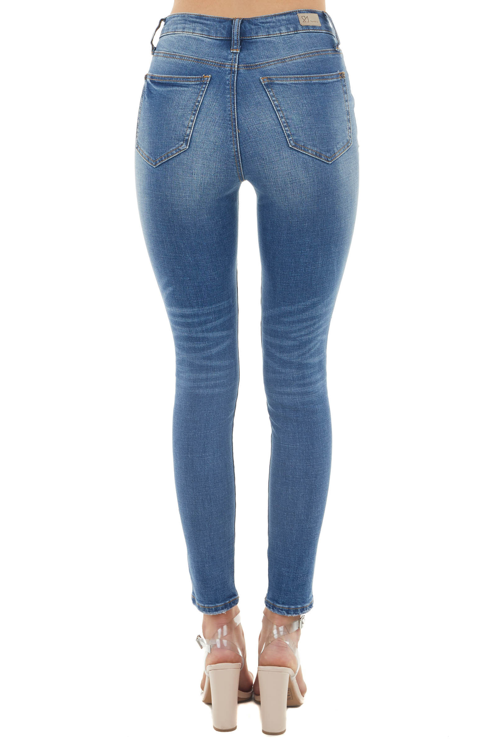 Medium Dark Wash High Rise Button Fly Skinny Jeans