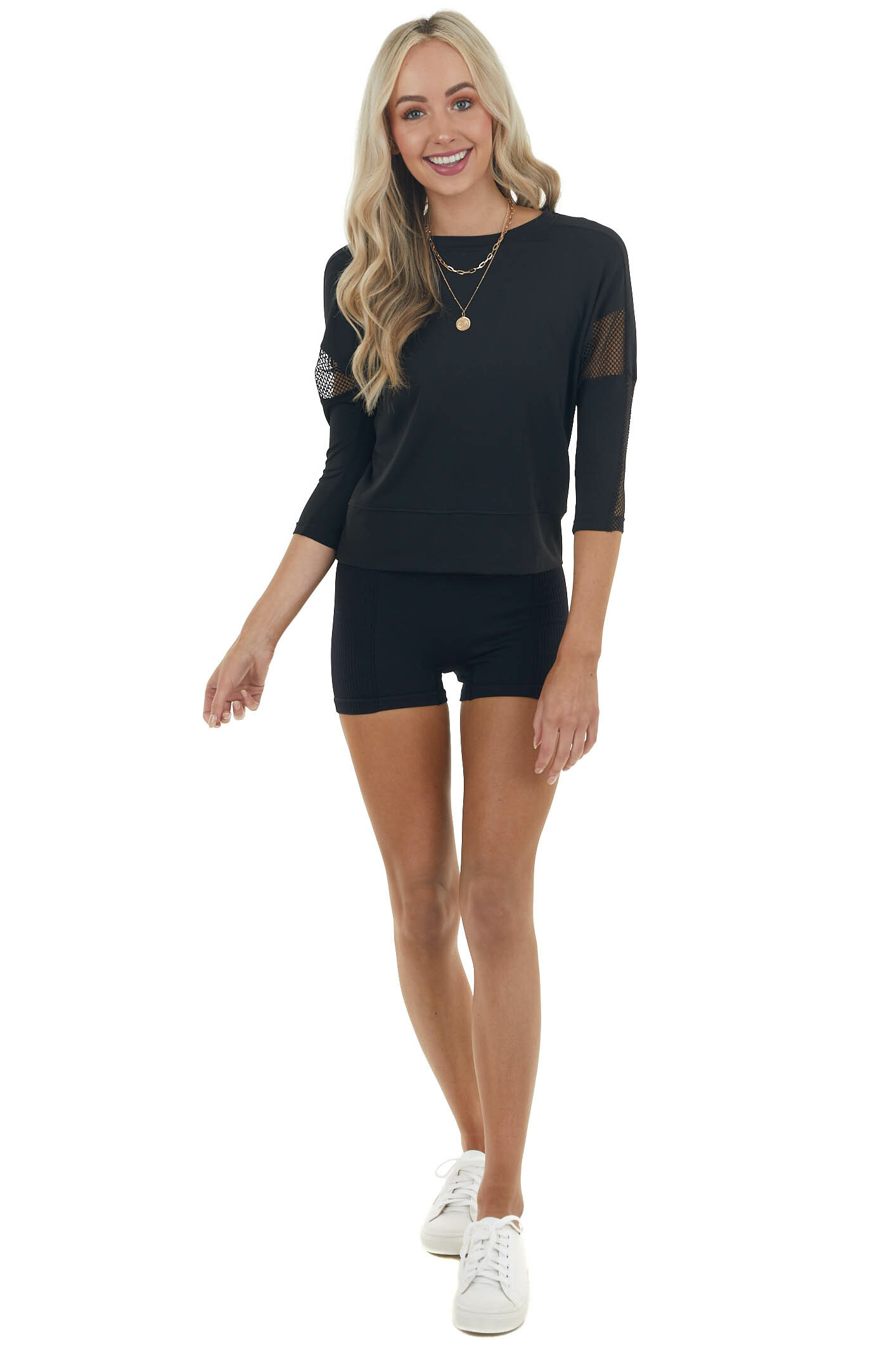 Black Stretchy Knit Top with Mesh Details and Back Cut Out