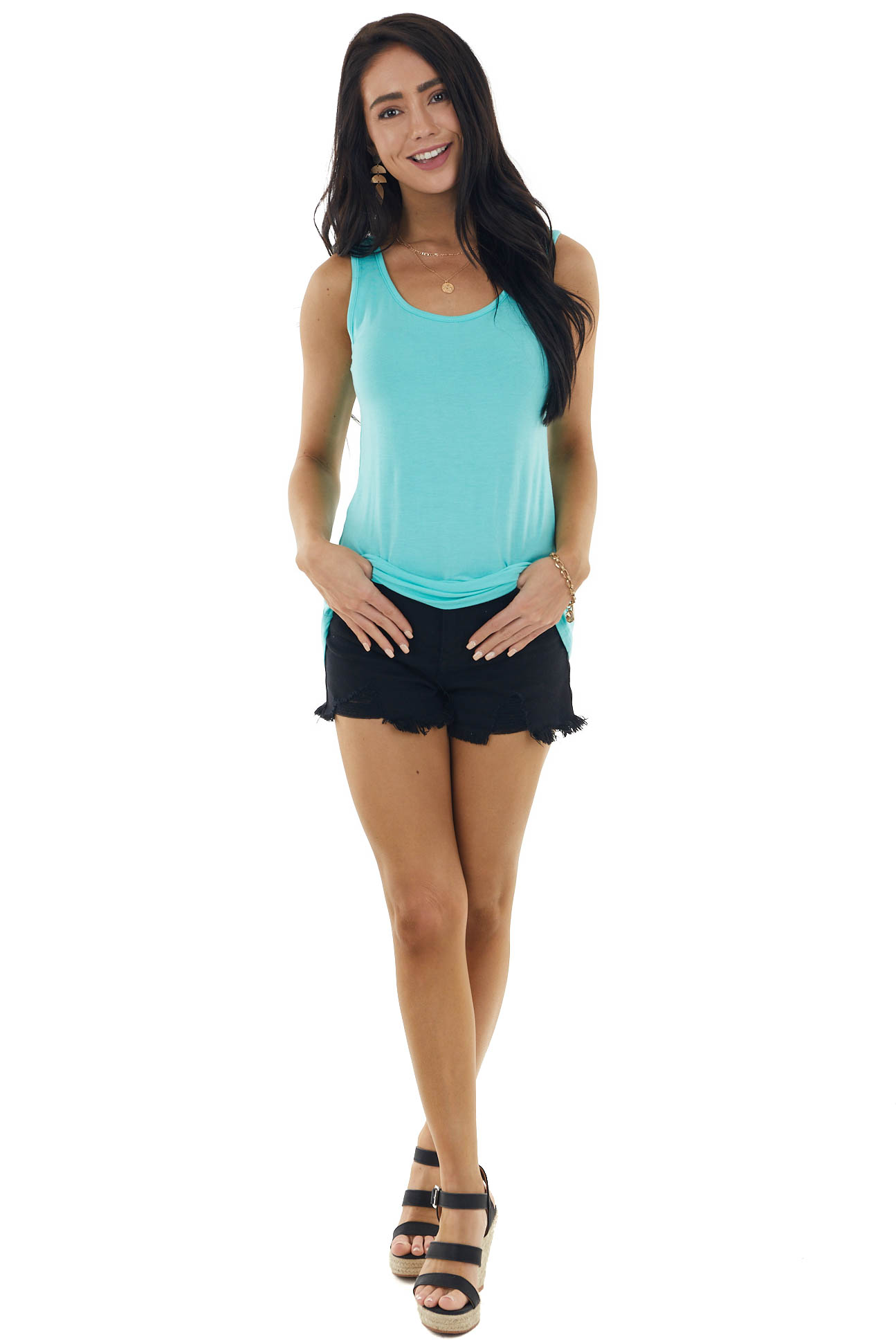 Turquoise Sleeveless Knit Top with Printed Bow Detail
