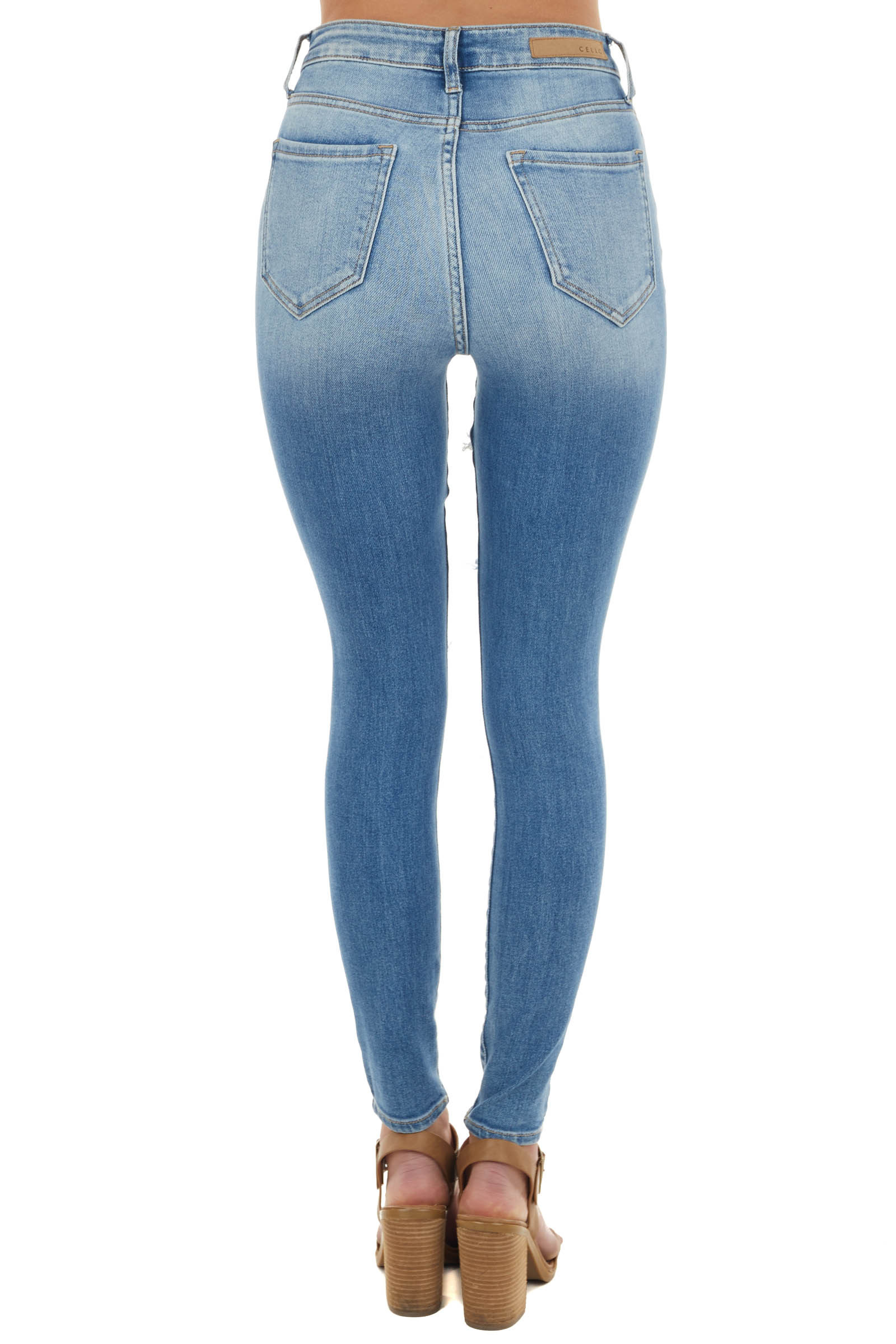 Medium Wash High Rise Skinny Jeans with Heavy Distressing