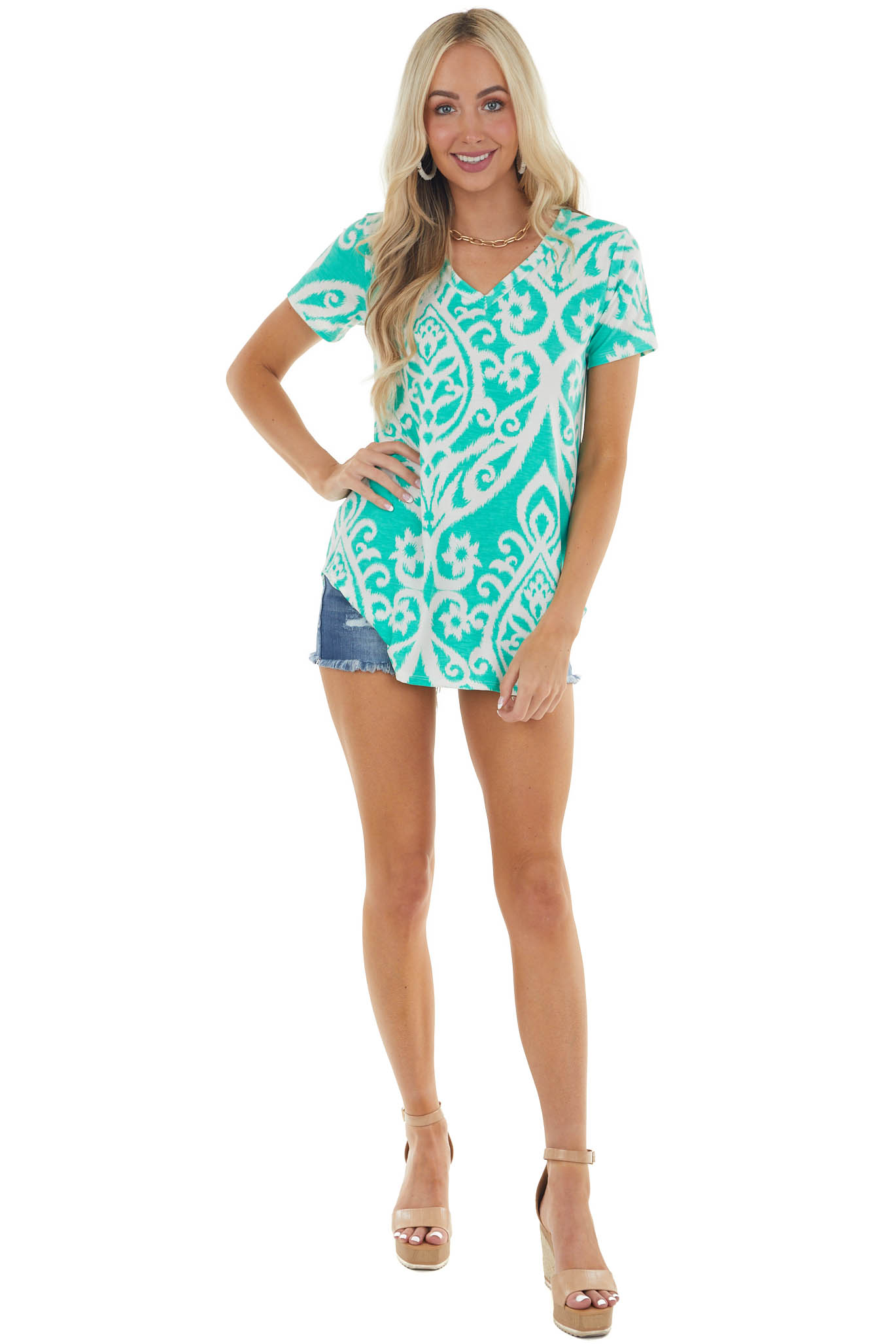 Turquoise Printed Stretchy Knit Top with Rounded Hemline