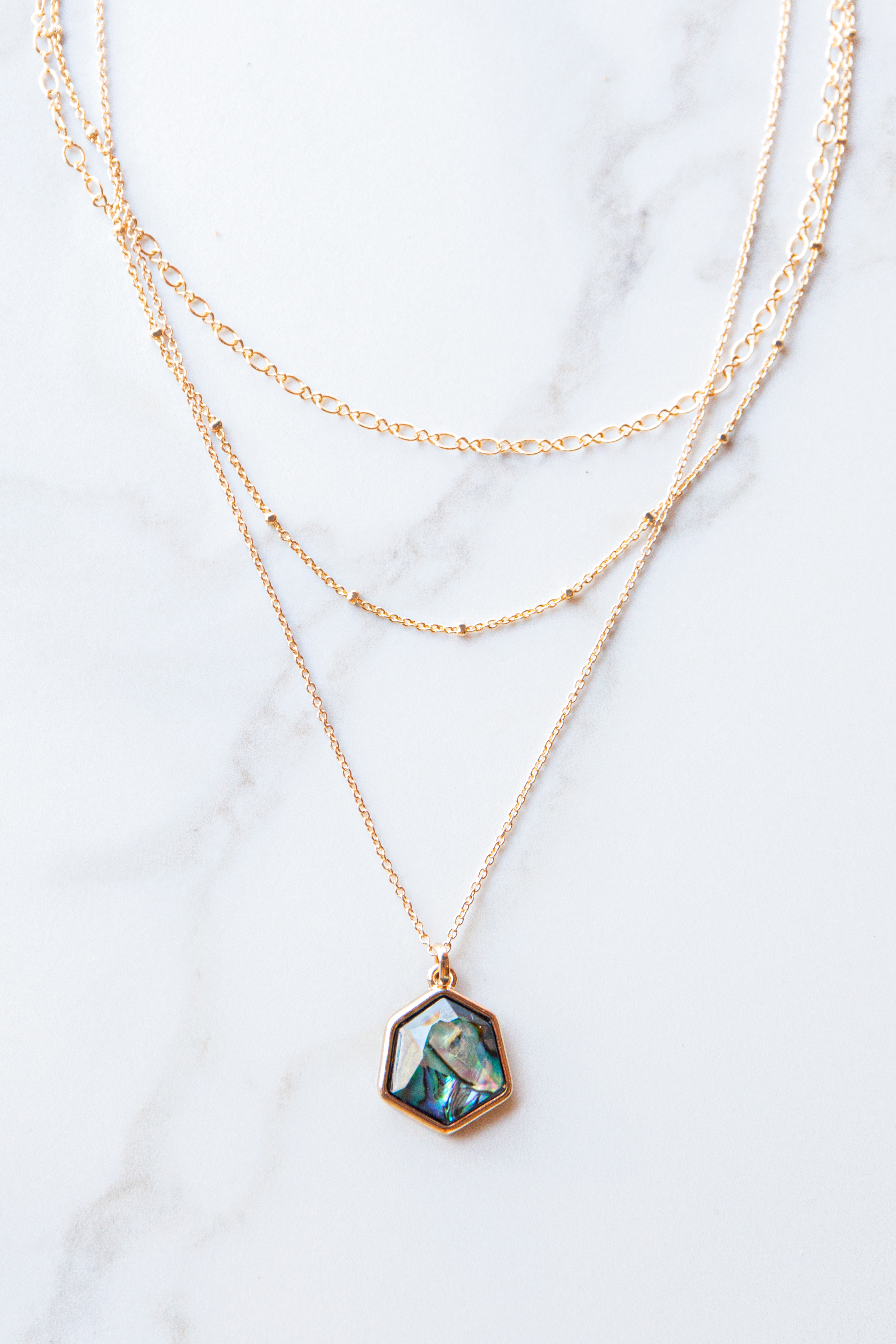 Gold Necklace with Marbled Stone Pendant