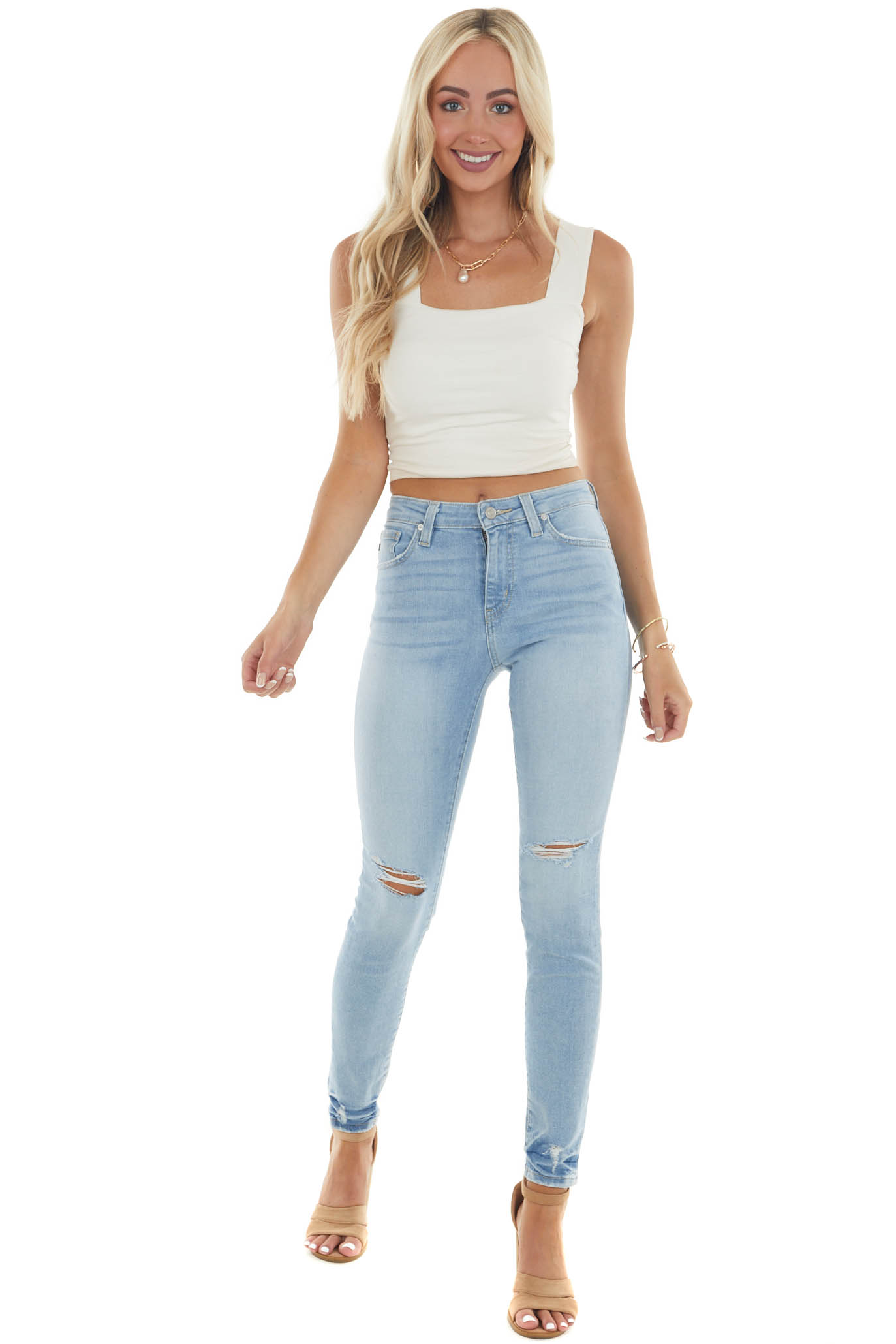 Light Wash High Rise Distressed Skinny Jeans