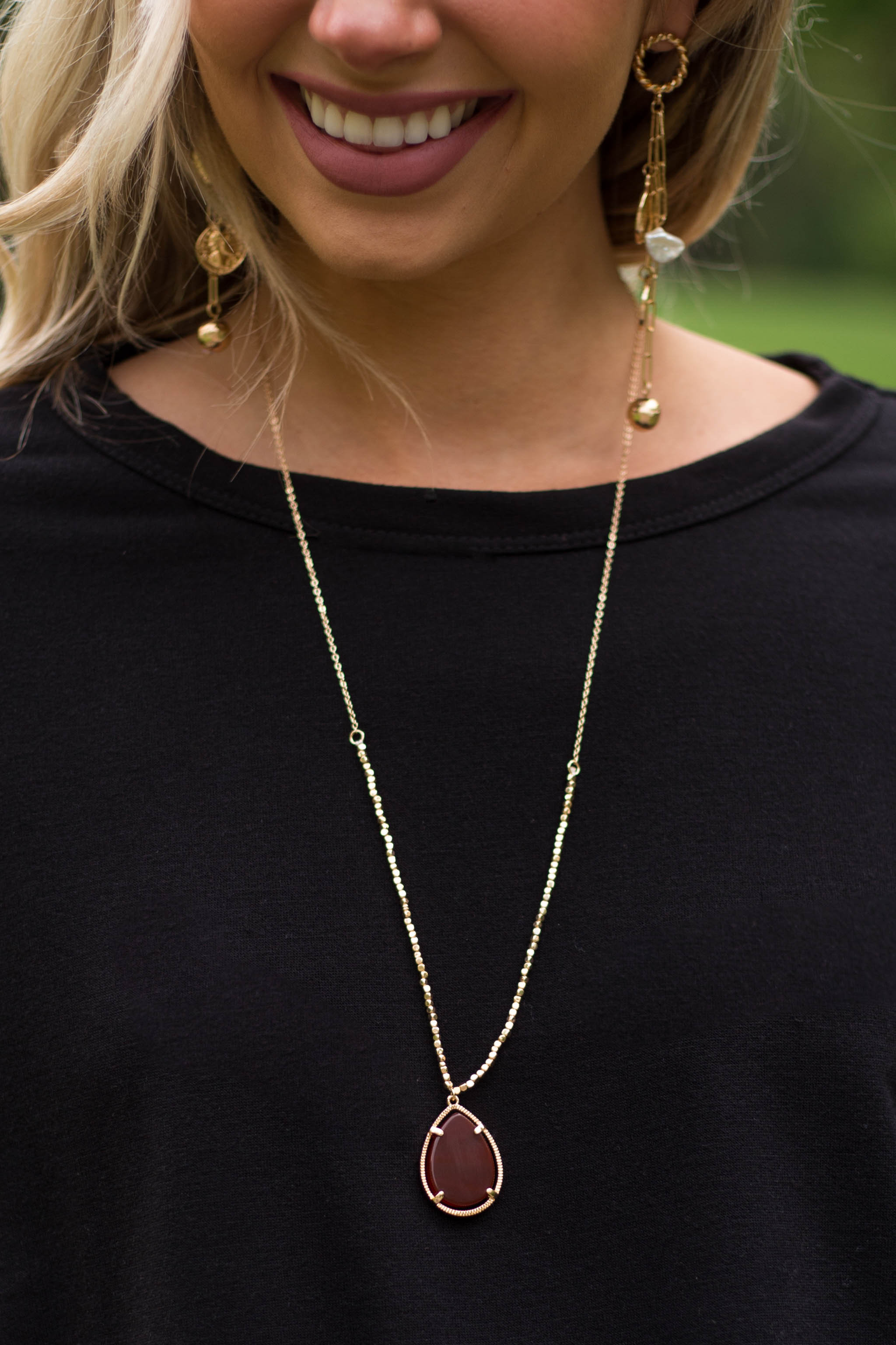 Gold Necklace with Beaded Details and Cherry Stone Pendant