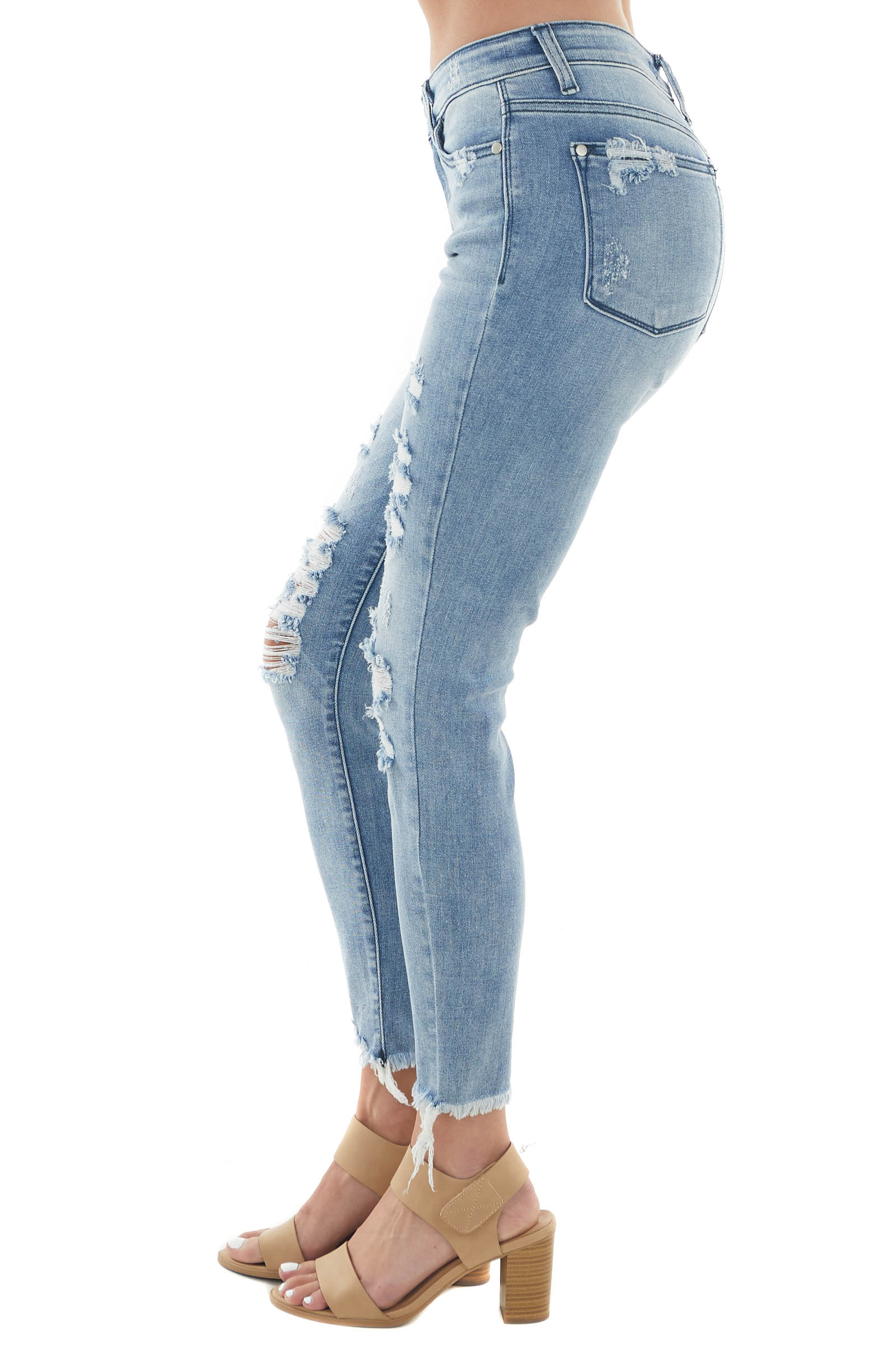 Light Mid Rise Heavily Distressed Skinny Jeans