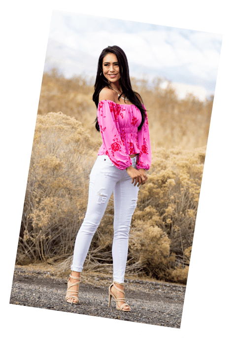 Brunette model wearing pink top with red flowers