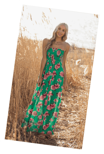 Blonde model wearing green dress with pink flowers