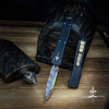 Marfione Custom UTX-70 D/E Spike Grind Hefted Black Handle Blued Mosaic Damascus Blade Blue Ti Hardware