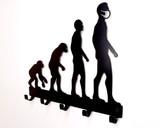 human evolution metal mask hanger