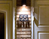 Top lit 55 house sign