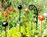 Assorted  metal garden stake black , copper in garden