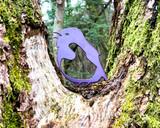 small metal purple robin in tree