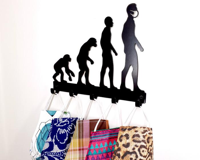 Human Evolution Mask Hanger