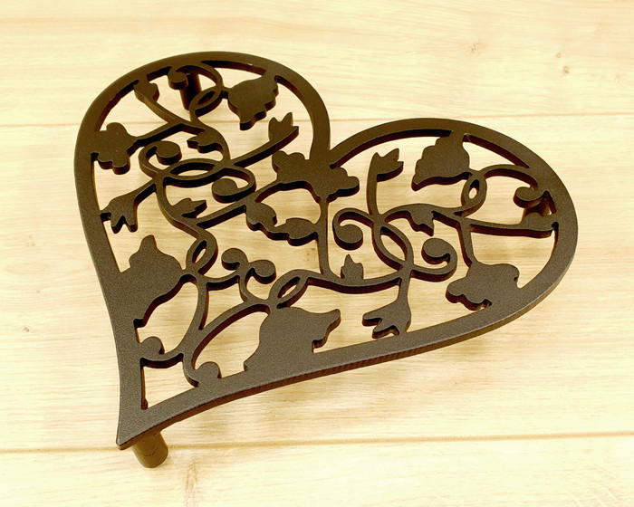 black metal  heart-shaped trivet