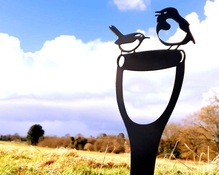 black robin and wren on spade
