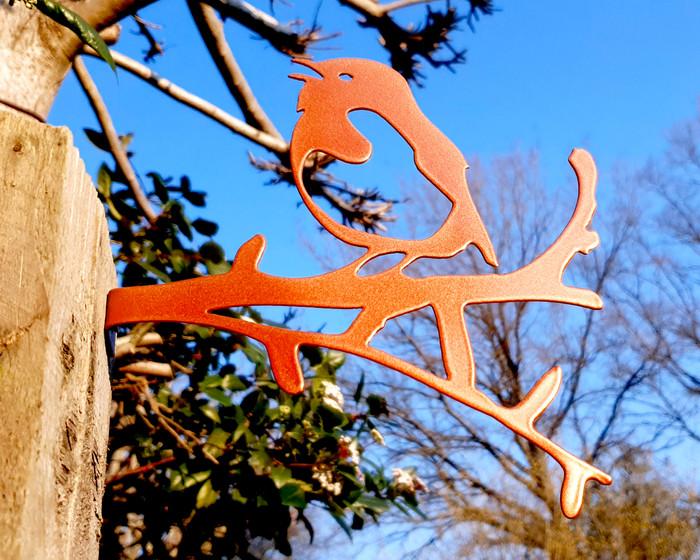 copper robin on a branch sculpture