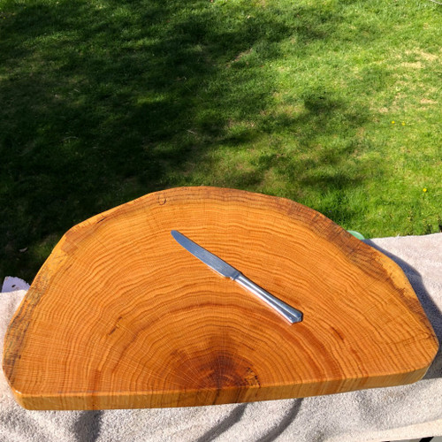 Treeboard's exclusive end-grain cutting boards, made of oak, in a photo with a table knife.