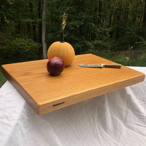 Our biggest chopping block yet is hewn from a solid slab of white oak and finished with raw linseed oil and Treeboard's exclusive board balm, made with linseed oil and carnauba wax.