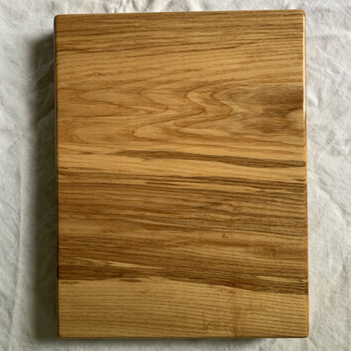 Ash cutting board by Treeboard, finished with organic raw linseed oil and carnauba wax, showing the grain detail. All natural. Top view