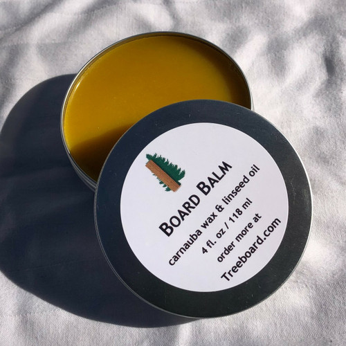 Board balm or wood wax by Treeboard, used for sealing moisture out of cutting boards, wooden spoons or for finishing any wooden surface. Some even use it for hand moisturizer or frizzy hair. The wax is made from carnauba wax and food-grade raw linseed oil, with no mineral oil or non-plant-based substances.