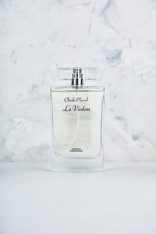 """""""Le Violon"""" is a woody, aromatic fragrance for the man who defies convention. The profoundly sensual perfume, infused with crisp citrus notes; offers an intense concentration of the fresh, clean, and vibrant fragrance. Unexpected and undeniably bold. """"Le Violon"""" belongs to the Woody and Aromatic fragrance family.  TOP NOTES The perfume opens with Lemon, Grapefruit, and Mint. HEART NOTES It continues to the foundation of Labdanum, Jasmine, Pink Pepper and Vetiver. BASE NOTES The last touch of the perfume is Nutmeg, Ginger, Sandalwood, Cedar, Incense, and Patchouli."""
