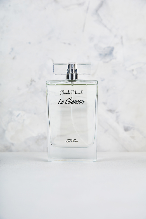 """""""La Chanson"""" is a scent of freedom to create your legacy and share it with the next generation. It is a classic men's fragrance that blends citrus, greens, and deep woods for a fresh long lasting scent. """"La Chanson"""" belongs to the Citrus & Aromatic Fragrance Family.  TOP NOTES The perfume opens with Rosemary, Neroli, Bergamot, Lemon, and Pineapple. HEART NOTES It continues to the foundation of Coriander, Jasmine, Oakmoss, and Cyclamen.  BASE NOTES The last touch of the perfume is Cardamom, Tonka Beans, Musk, Sandalwood, Oakmoss, Brazilian Rosewood, and Cedar."""